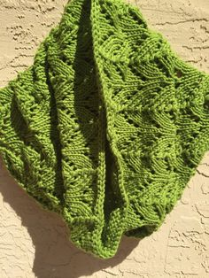 An uncomplicated lace knit cowl in Berroco Comfort. Knit in a blend of nylon and acrylic. Perfect for spring wear.
