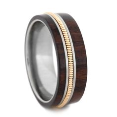This custom made guitar string jewelry was made for all you music lovers. This bolivian rosewood wedding band features an actual guitar string. Your wedd. Titanium Wedding Rings, Custom Wedding Rings, Titanium Rings, Wedding Ring Bands, Wood Wedding Rings, Wedding Jewelry, Wood Inlay Wedding Band, Guitar String Jewelry, Band Engagement Ring