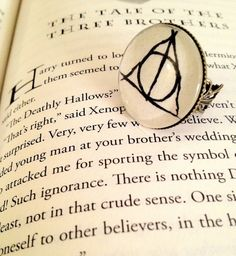 Deathly Hallows Antiqued Bronze Book Page Ring. $15.00, via Etsy.