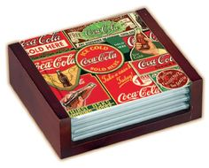 $9.51-$12.95 These Coca-Cola licensed  glass coasters are perfect for serving wine, as the smooth glass surface protects delicate stemware.  These functional coasters feature 3 1/2-inch tempered glass and have non-skid feet.  Coasters are nested in an elegant wood holder.  Set of four.