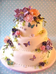 This is my first wedding fair dummy cake for 2011 and like other years the flowers are from some of last years cakes. I always make more than I need and end up with boxes full of assorted colours and blooms!!