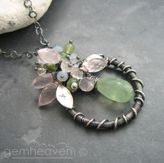Wire wrapped pendant, coiling and clusters.  I would also add wire vines to the frame.