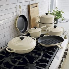 Revered by both professional chefs and home cooks since its 1925 debut, Le Creuset's classic French cookware is prized for its utilitarian good looks and unsurpassed heat retention. In a fresh cream color you'll find only at Crate and Barrel, our cast iron cookware is clad in smooth, vitrified porcleain, rendering each piece impervious to acid, alkali, odors and stains. Non-reactive cooking surface does not require seasoning. Compatible with all types of heat sources, from gas and electric…