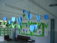 spring flowers: would look like a veritable garden in many different colours Birthday Decorations, Classroom Decor, Spring Flowers, Different Colors, Tulips, Hands, Colours, Drawings, Artwork