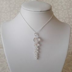 Beautiful pendant drop necklace made with Swarovski faceted round crystals in graduated sizes to give the look of a frosty icicle, the crystals