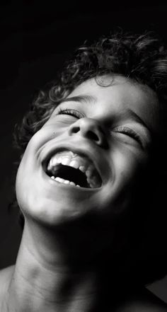 adorable boy laughing