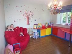 Cute playroom. I like the extra storage and counter space.