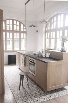 Mélange de styles dans la cuisine de cet appartement familial
