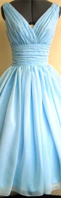 IN FACT, I AM THE TIP OF THE ICEBERG, THERE ARE SO MANY STORIES UNTOLD!. Sky blue chiffon tea length dress with V neck and ruched waistband.