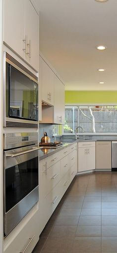 20 Galley Kitchen Design Ideas - Layout and Remodel Tips Stylish Ways to Decorate galley kitchen remodel for 2019 Galley Kitchen Design, Simple Kitchen Design, Galley Kitchen Remodel, Small Space Kitchen, Best Kitchen Designs, Kitchen Layout, Kitchen Colors, Kitchen Themes, Kitchen Decor
