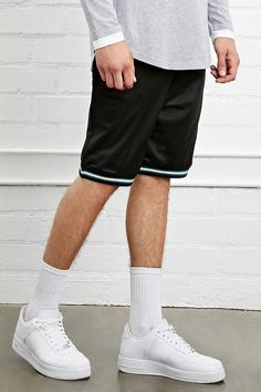 """A pair of jersey knit athletic shorts featuring a drawstring waist, varsity striped trim, and a """"Represent 79"""" graphic on the lower left leg. #forever21men"""