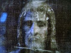 Another close up from a 3D image of the Shroud of Turin, two bruised and swollen eyes one more injured than the other, fractured and scabbed nose, and blood around the sides and top of our Lord's head