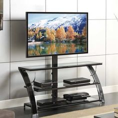 "Your electronic components will look perfect in the 50"" 3-in-1 flat panel TV console. The sweeping curved legs and frame of gloss black with chrome trim and tempered glass shelves is the ideal match for today's electronics. Design and function go hand-in-hand with three TV display options available. Use the rear column with built-in swivel mount, hang on the wall using the universal bracket provided or use your TV's stand and place on the top shelf. The swivel mount pan…"