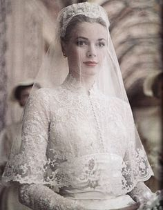 Elegant Grace Kelly in her wedding dress.... one of my favorite wedding dresses of all time.