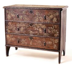 Lift top chest with drawer, attributed to Robert Crossman (1707–1799), Taunton, Mass., 1731. White pine, iron cotter pin hinges, cast brass pulls and escutcheons with bright-cut engravings; 32 by 35½ by 17¼ inches. Twenty-one Taunton chests are known. This one was auctioned in 2001 by Independent Appraisers and Auctioneers of Bronxville, N.Y.