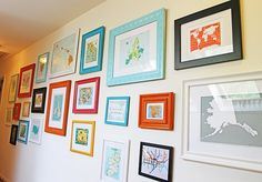funky wall of maps, collected in honor of special places...cheap frames spray painted with Krylon pumpkin orange, Blue Ocean Breeze, Raspberry and a few others.  {LOVE this idea for kids artwork wall in the playroom!}