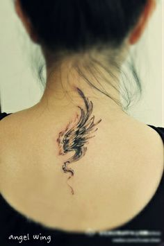 single #Angel wing #tattoo on the back with wind around it