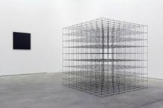 Foreground: Mona Hatoum, Cube (9 x 9 x 9) (2008),