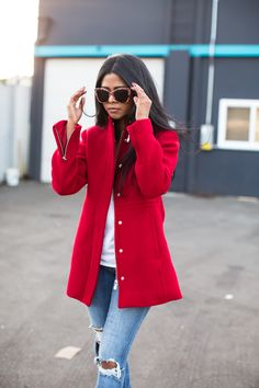 Sheryl Luke from Walk In Wonderland adds a pop of color to her winter wardrobe in the red wool coat from Banana Republic.