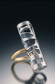 14k gold, oxidized sterling silver; pierced, fabricated. 1-1/2 x 1/2 x 1/2 in. (38 x 13 x 13 mm). Photo by Hap Sakwa. Posted by Kristin Sutter on Art Jewelry Magazine Gallery