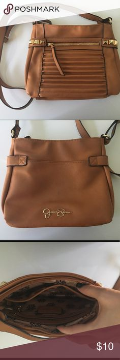 Jessica Simpson Crossbody Cognac colored with gold hardware. Zip closure. Leather material (not sure if real or man-made) Two interior pockets and one zip enclosure. Drop length shown in pics.  Very slight discoloration on back. Jessica Simpson Bags Crossbody Bags