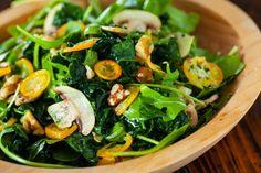 Kale Kumquat Salad Recipe: sliced kumquat citrus, fresh mushrooms, walnuts and an easy citrus vinaigrette made in a mason jar.  From www.SteamyKitchen.com