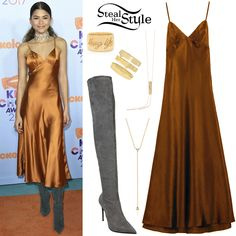 Zendaya attended the Nickelodeon Kids' Choice Awards tonight wearing a Daya by Zendaya Satin Slip Dress ($38.00 – wrong color), an EF Collection Diamond Trio Lariat Necklace ($850.00), a Dana Rebecca Necklace (Not available online), a Thug Life Ring ($2,400.00) and 3 Mate Rings ($2,000.00) both by Established, and LeSilla Suede Over-The-Knee Boots ($1,081.00).