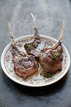Lemon-Thyme Lamb Chops (L'agneau grillé au thym) by Saveur. The recipe for these lamb chops comes from the book Patricia Wells at Home in Provence: Recipes Inspired By Her Farmhouse In France.