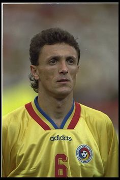 Portrait of Gheorghe Popescu of Romania before the start of the game against Switzerland during the World Cup Finals in the USA Consigue fotografías de noticias de alta resolución y gran calidad en Getty Images World Cup Final, Football Players, Real Madrid, Soccer, Portrait, Celebrities, Switzerland, Brazil, People