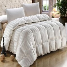Goose down silk comforter duvet. The ultimate in luxury is this 900 thread count silk goose down comforter duvet. With a beautiful and classic striped pattern and box baffle design, this is overstuffe Down Comforter, King Comforter, White Silk, California King, Luxury Bedding, Bedding Sets, Duvet Covers, Comforters, Count