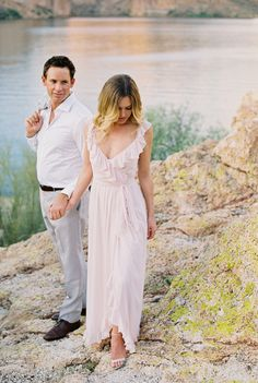 Photographed by Charity Maurer, this couple was captured before a storm, with colorful, windy skies creating a romantic atmosphere. Engagement Photo Outfits, Engagement Photo Inspiration, Engagement Session, Engagement Photos, Fashion Couple, Bridesmaid Dresses, Wedding Dresses, Casual Summer Outfits, Style Guides