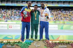 Silver medalist Luiz Arturo Paiva of Venezuela, Gold medalist Daniel Martins of Brazil and Bronze Medalist Gracelino Tavares of Cape Verde celebrates on the podium at the medal ceremony for the Men's 400m - T20 at the Olympic Stadium on Day 2 of the Rio 2016 Paralympic Games on September 9, 2016 in Rio de Janeiro, Brazil.