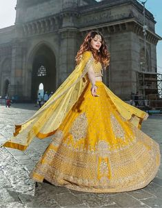 Because you will instantly fell in love with this monochrome yellow lehenga yes! the super elegant looks eternally beautiful as she shoots at the most popular tourist attraction The Gateway Of India. She cuts a p Choli Designs, Lehenga Designs, Designer Bridal Lehenga, Indian Lehenga, Indian Dresses, Indian Outfits, Indian Skirt, Dresses Dresses, Bridal Outfits