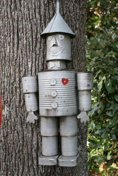 Recycle tin cans for garden art art from junk upcycling Tin man Tin Can Crafts, Metal Crafts, Diy Crafts, Aluminum Crafts, Upcycled Crafts, Repurposed, Tin Can Man, Tin Man, Recycled Tin Cans
