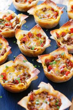 These fun Crunchy Taco Cups are made in a muffin tin with wonton wrappers! Great… These fun Crunchy Taco Cups are made in a muffin tin with wonton wrappers! Great for a taco party/bar.