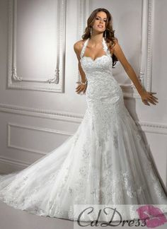 Halter wedding dress. #Wedding #Beauty #Style Visit Beauty.com for all your beauty needs.