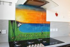 This beautiful bespoke glass splashback found a home in Lower Largo, Fife, and there's plenty of personalisations to feast your eyes on. The customer behind the piece was looking to have a scene created, and was a fan of our sunset style splashbacks. As she was half-Italian, much like our own Lisa Villarospo, she had the idea for a more mediterranean scene. You can see many elements working together to evoke that specific location.