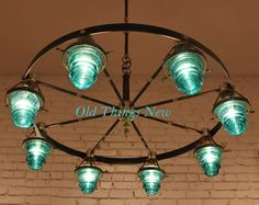 insulator chandelier! I like this a lot.. maybe a mason jar (stained blue) in the middle?
