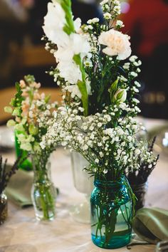 DIY wild flower floral arrangements, vintage wedding, mason jar, glass vases- My design for my wedding and beautifully executed by my bridesmaids, family and friends <3