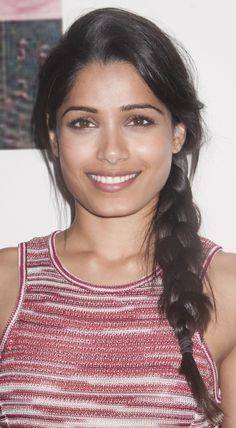 Freida Pinto hairstyles: down and straight vs. side braid