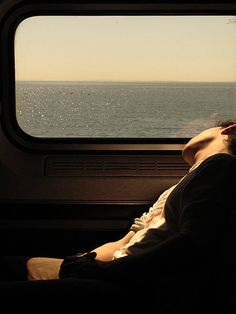 Asleep on the train as it passes by the Mediterranean. #trains #travel #passengers