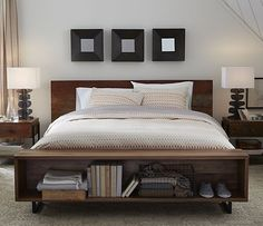 This Rustic Bed's eclectic nature mixes reclaimed peroba wood from Brazil with refined solid American black walnut. The bed also offers plentiful storage in the footboard, which features a built-in bookcase.