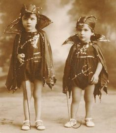 Vintage Halloween photo, children in devil costumes