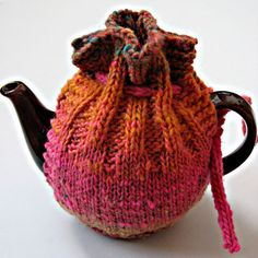 The Kureyon Kozy knitting pattern was designed by Emma Crew and featured free on Knitty back in 2004. It's such a cute design and reminds me rather of a present wrapped up in knitting, which is why I am featuring it now on the run up to Christmas. photo courtesy of acechick This tea cosy…