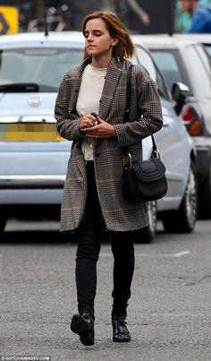 Stylish as ever: Emma Watson was showcasing her flair for fashion as she stepped out in London on Friday