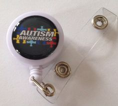 Check out this item in my Etsy shop https://www.etsy.com/listing/184419327/autism-awareness-themed-id-badge-reel