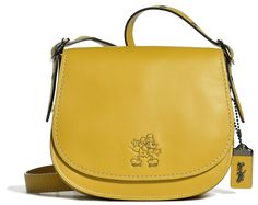 Disney x Coach Is Coming — & It's As Adorable As We'd Hoped #refinery29  http://www.refinery29.com/2016/06/113405/disney-mickey-mouse-coach-collaboration-2016#slide-7  A cheery yellow can be your new neutral....