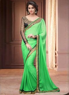Bottle green saree with blouse. Work - Embroidered patch border and embroidery work on blouse. Paired with the matching blouse piece.Please Note: The shades may vary slightly from the colors displayed on your screen. Blue Silk Saree, Green Saree, Art Silk Sarees, Chiffon Saree, Georgette Sarees, Party Wear Sarees Online, Party Sarees, Buy Sarees Online, Blouse Online