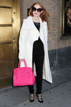 Jessica Chastain matches her lips to her bag