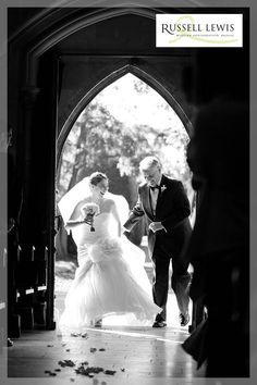 Bride and dad laughing whilst entering Belmont Abbey prior to her wedding ceremony